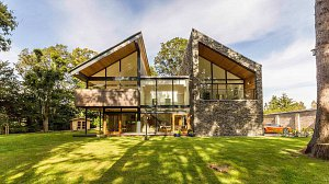 Architect designed house in Blairgowrie Perthshire in woodland setting with natural slate walls